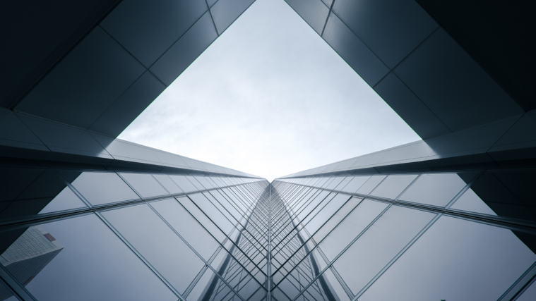 upward angle of a modern skyscraper with an opening to the sky
