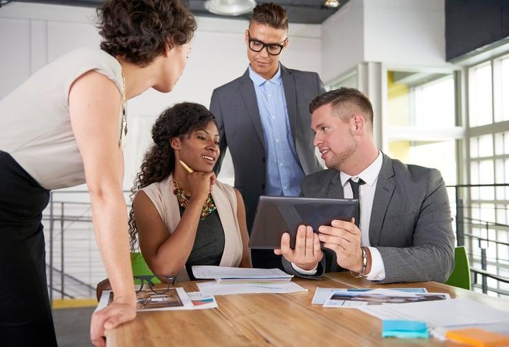 business people in a metrics meeting