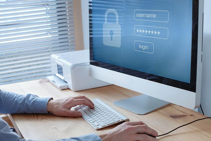 man logging into secure computer