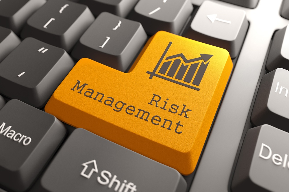 Orange Risk Management Button on Computer Keyboard. Business Concept..jpeg